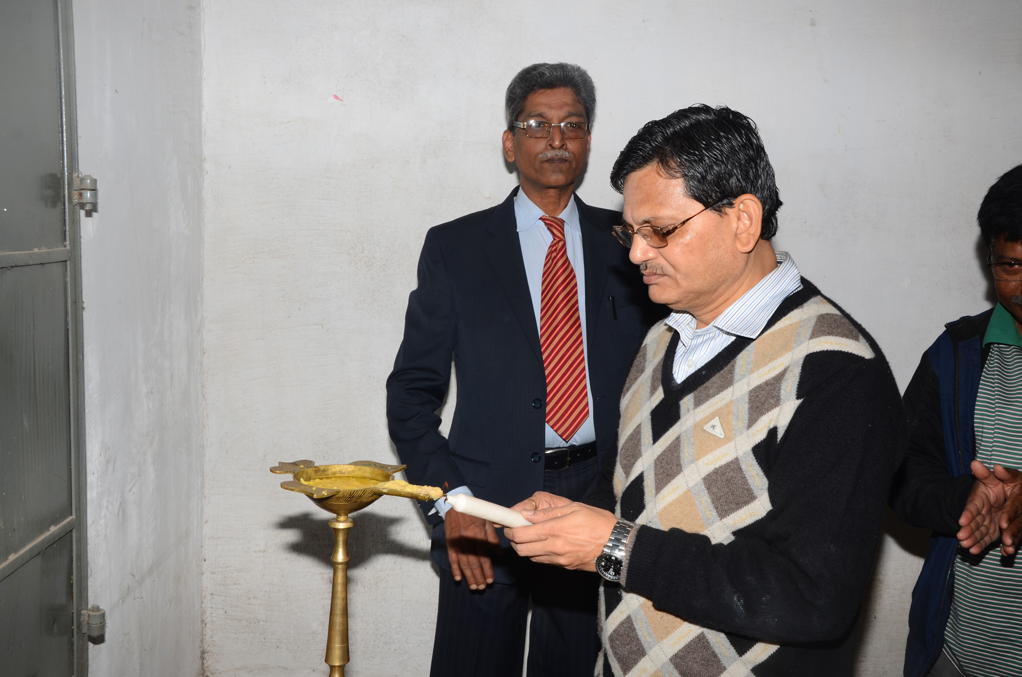 Lightening the lamp by Prof. Sudhanshu Sekhar Rath, OSD, G.M. University at 1st Induction Meeting of OSOU at G.M. University Campus.